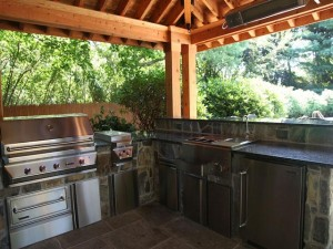 San Diego BBQ Grills Beautiful Outdoor Kitchen Space, Outdoor Living Space, and BBQ Grill with custom counter-tops in an outdoor living space with a wooden canopy